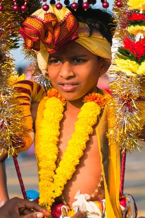 20 January 2011, Kuala Lumpur, Malaysia: A young boy devotee carrying the ceremonial kavadi as part of a thanksgiving ritual during the annual Thaipusam festival.