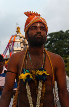 hypnotise: 20 January 2011, Kuala Lumpur, Malaysia: A devotee in a trance state as he wanders the festival grounds in a stupor during the annual Thaipusam festival. Editorial