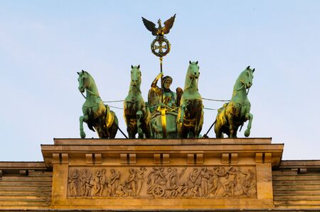 brandenburg gate: The quadriga - chariot pullled by four horses - on top of the Brandenburg Gate in Berlin. Stock Photo