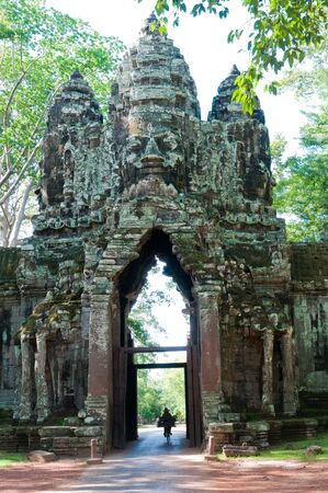 A gateway into the largest temple complex of Angkor. Stock Photo