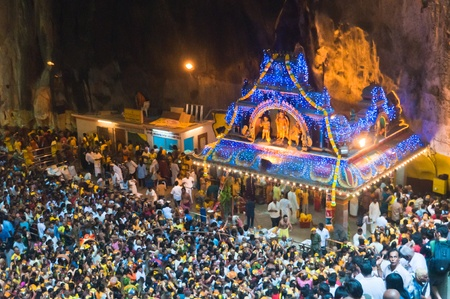 20 January 2011, Kuala Lumpur, Malaysia: Over a million people gather at the Batu Caves for the annual Thaipusam festival, culminating at the temple within the massive cave complex. Stock Photo - 9272258
