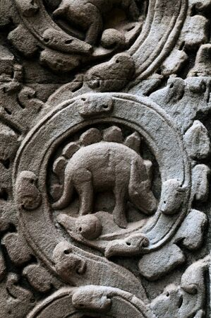 Carved animal, resembling a stegosaurus, in the temples of Angkor  Possible a rhino or pangolin