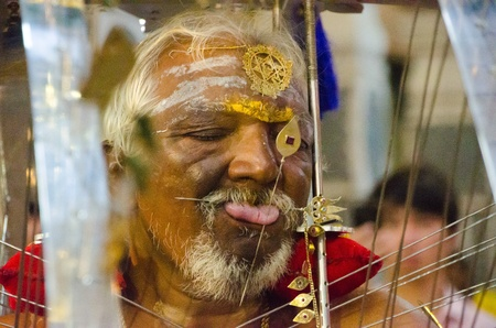 7 February 2012, Singapore: An elderly Hindu devotee is skewered through the cheeks and tongue during the annual Thaipusam festival. Editorial