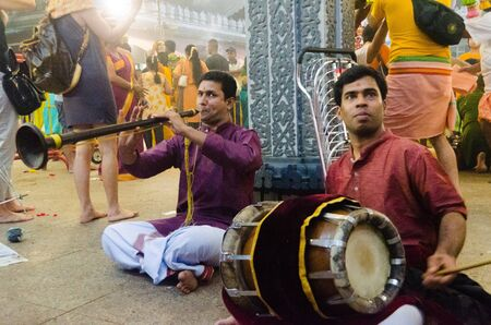 Singapore, 7 Feb 2012. A pair of street musicians adding revelry to the annual Thaipusam festival in Singapore.