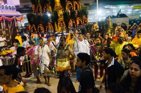 Singapore, 7 Feb 2012. A kavadi carrier begins his walk in the annual Thaipusam festival.