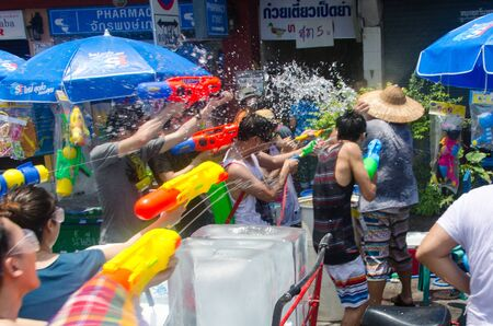 shootout: Bangkok, Thailand, 14 April 2015. Festival goers at Khao San Road spraying each other with water guns during the annual Songkran water festival. Editorial