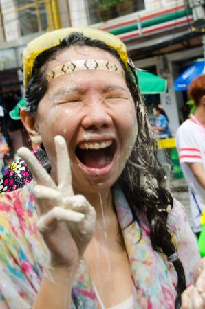 Bangkok, Thailand, 13 April 2015. A festival goer at Khao San Road after just been soaked with water during the annual Songkran water festival.