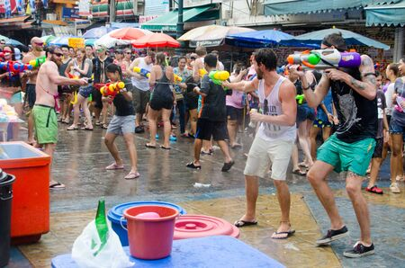 standoff: Bangkok, Thailand, 13 April 2015. Festival goers battle it out with water guns during the annual Songkran water festival in Khao San Road.