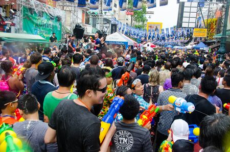 standoff: Bangkok, Thailand, 13 April 2015. During the annual Songkran water festival in Thailand the backpacker haven Khao San Road is closed to public for a massive street party Editorial