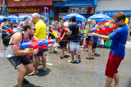 standoff: Bangkok, Thailand, 14 April 2015. Festival goers at Khao San Road spraying each other with water guns during the annual Songkran water festival. Editorial