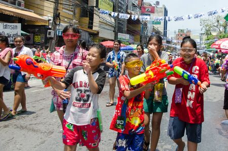 standoff: Bangkok, Thailand, 14 April 2015. A group of children armed with their water guns at the the annual Songkran water festival at Khao San Road.