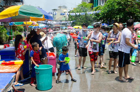 standoff: Bangkok, Thailand, 14 April 2015. Groups of partygoers splahs water at each other using water guns, buckets and hoses. The annual Songkran water festival is marked by splashing water on each other.