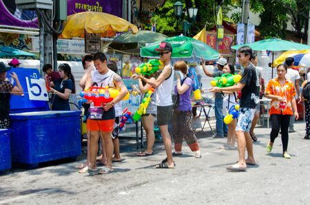 Bangkok, Thailand, 13 April 2015. Festival goers at Khao San Road spraying each other with water guns during the annual Songkran water festival. Editorial