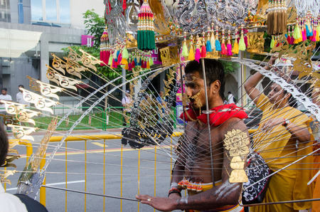 kavadi: 7 Feb 2012 Singapore: A male devotee carries the kavadi a piercing harness as part of the Thaipusam festival in Singapore.