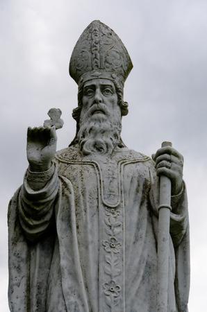 patron saint of ireland: A statue of St Patrick patron saint of Ireland on the Hill of Tara. Stock Photo