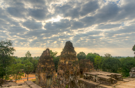 Cloudy skies over the sunrise in Pre Rup temple in Angkor.