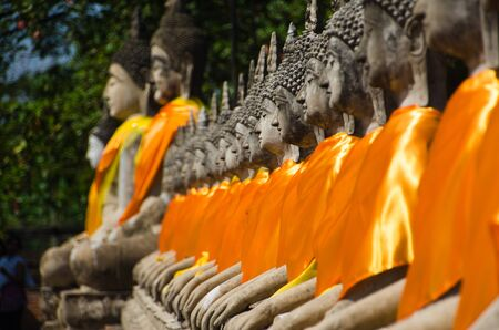 Rows of seated Buddhas at the Ayutthaya Historical Park in Thailand.