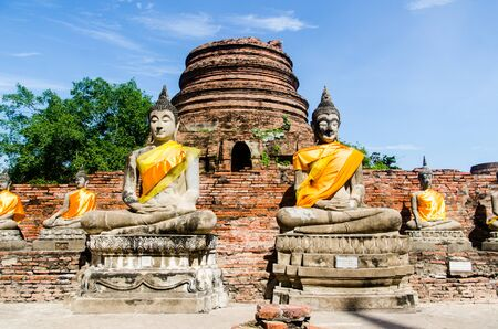 Sculptures of seated Buddhas in meditation in the ancient city of Ayutthaya.