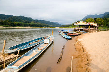 ou: Boats docked at Ban Pak Ou, in the Laos portion of the Mekong River.