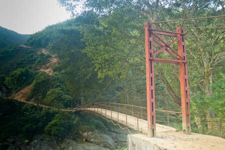 A bridge leading to one of the many mountain trails in Vietnams Sa Pa province. Stock Photo