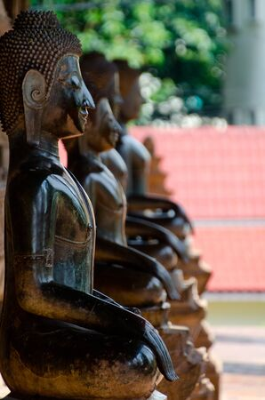Various sculptures of the Buddha seated in meditative positions Stock Photo