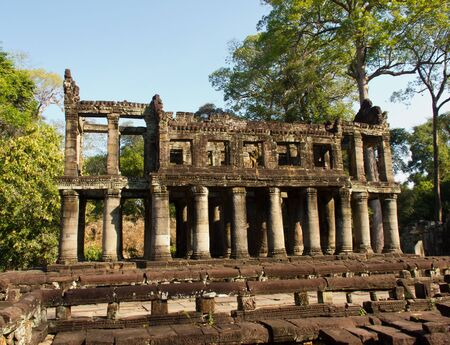 Crumbling ruins of an ancient temple chapel in Siem Reap, Cambodia Stock Photo