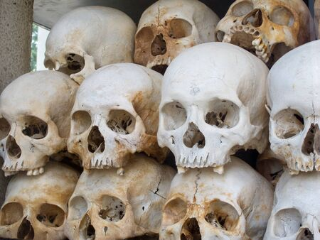 Closeup of the skulls collected and on display at Cheung Ek, one of the killing fields from Cambodias civil war Stock Photo