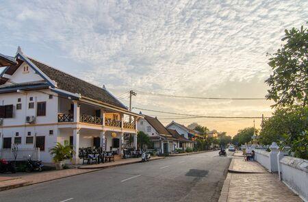 Luang Prabang, Laos - 8 December 2016: Sunset over Sakkaline Road, one of the main roads running through the heritage zone of Luang Prabang