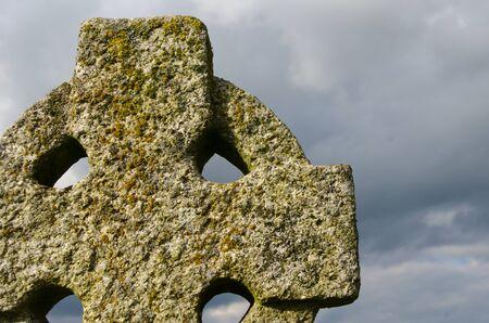 Old stone cross on the Hill of Tara in Ireland