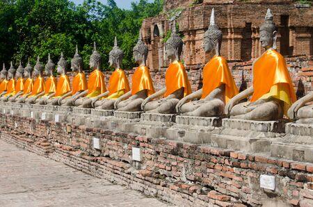 Row of stone Buddhas in seated meditation pose Stock Photo
