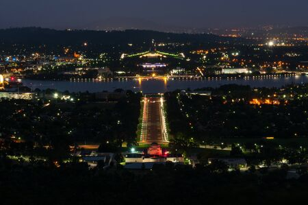 View of Canberra city by night, overlooking the Australian War Memorial, Lake Burley Griffin and the Parliament House