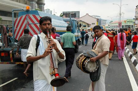 7 February 2009 - Georgetown, Penang: A pair of street musicians add revelry to the Thaipusam procession in Penang Editorial