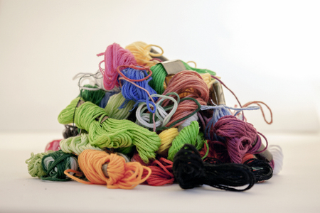 big amount of different colour and dimensions threads photo