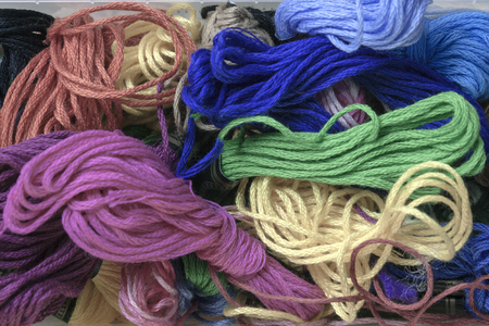 group of diferente multicolored balls of thread photo