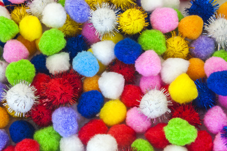 pompon: set of different colours and shapes of pompoms Stock Photo