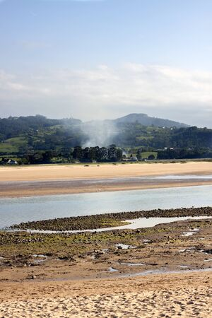 scenary: a landscape with smoke in a magnificent scenary of a estuary
