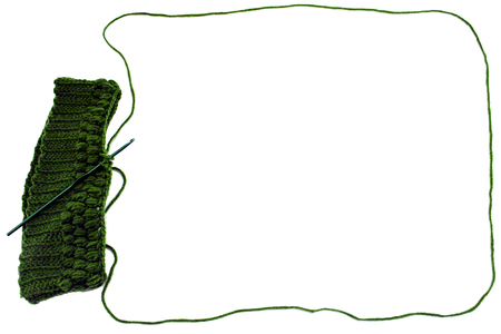 crotchet: an isolated unfinished crochet hat with a kind of balloon Stock Photo