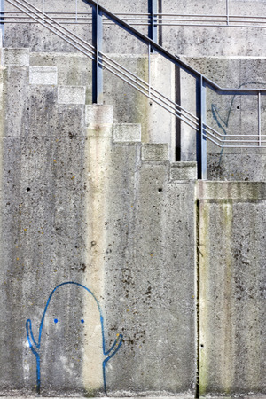 descends: a graffiti of a ghost in a wall of a ladder Stock Photo