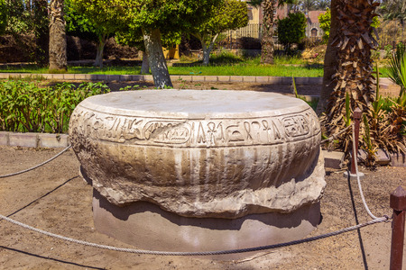 pillage: a horizontal view of an Egyptian pedestal in the street