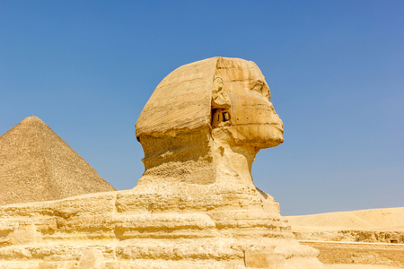 cheops: Sphinx statue and pyramid of Cheops on the background, Egypt