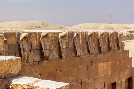 djoser: a horizontal view of some cobras of the tomb of Djoser, Saqqara, Egypt