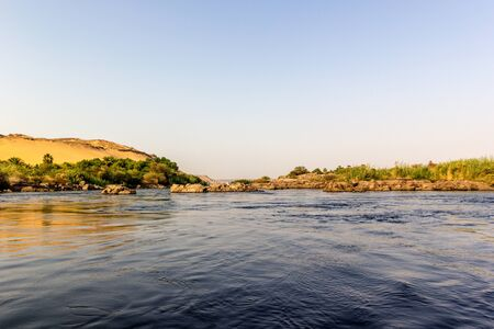 a horizontal view of a scene of the Nile River, Egypt