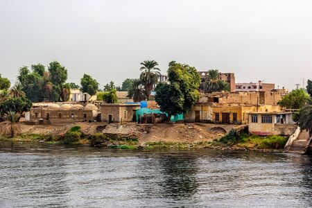 nile river: a horizontal view of a little village at he banks of the Nile river