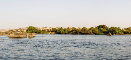 a panoramic view of Aswan from Nile River, Nubia, Egypt Stock Photo