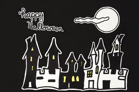 halloween message: a horizontal overhead view of a Halloween scene: houses with a moon and clouds and a happy halloween message