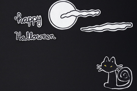 halloween message: a horizontal overhead view of a Halloween scene: cat with a moon and clouds and a happy halloween message