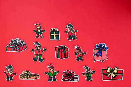 elfs: a horizontal overhead view of a xmas decorations made by elfs and presents