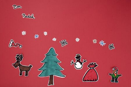 galician: a horizontal overhead view of a scrapbook xmas greeting with a Happy xmas message in Catalonian or Galician