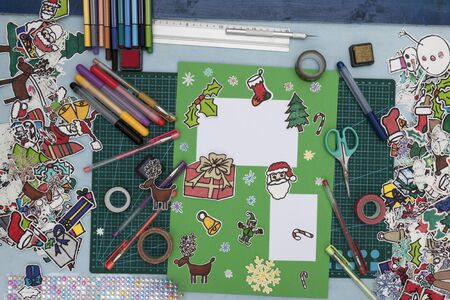needed: a horizontal overhead view of a scrapbook xmas layout with some of the tools needed