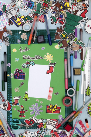 st german: a vertical overhead view of a scrapbook xmas layout with a Happy xmas message in German